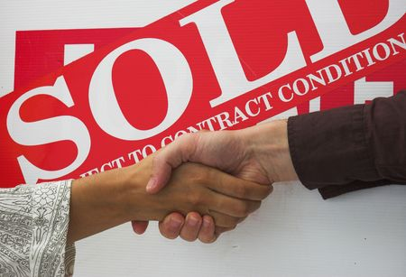Business people seal contract for sale with a handshake. Stock Photo - 352824