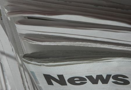 Stack of newspapers with focus on the word news on top paper. photo