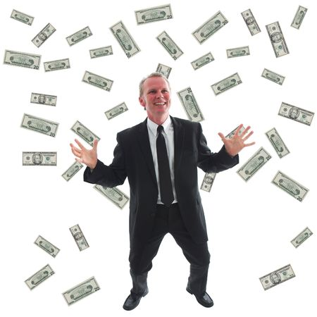 ecstatic: Ecstatic businessman surrounded by US dollars.