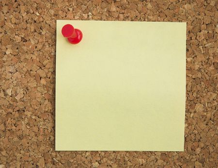 pinned: Blank Postit note pinned on cork noticeboard.