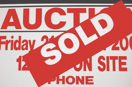 indicates: Sign indicates Home successfully sold at auction.