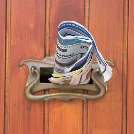 advertising material: Advertising material posted into a residential letter box. Stock Photo