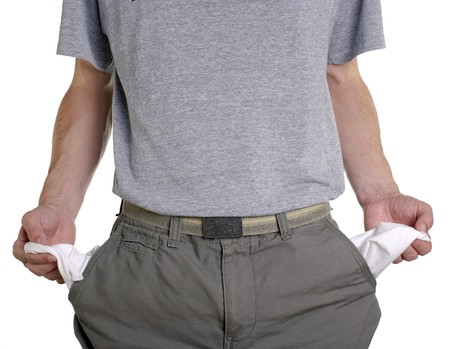 broke: Conceptual shot of man with empty pockets in tough economic times