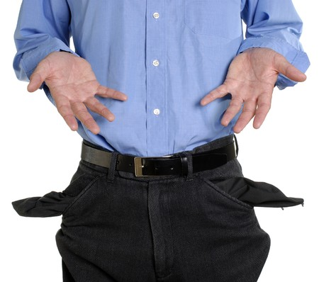 Conceptual shot of business man with empty pockets in tough economic times photo