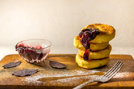 healthy curd pancakes with fresh berry sauce