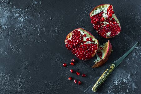 ripe red pomegranate on and grain on a gray background Stok Fotoğraf - 133878352