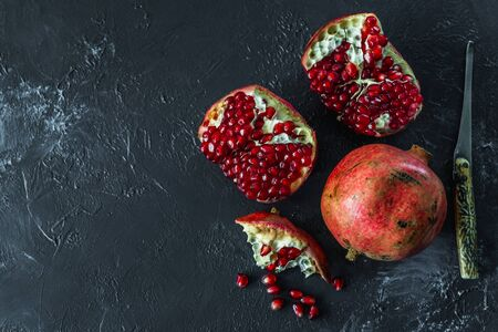 ripe red pomegranate on and grain on a gray background Stok Fotoğraf - 133878359