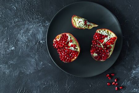 ripe red pomegranate on and grain on a gray background Stok Fotoğraf - 133878360