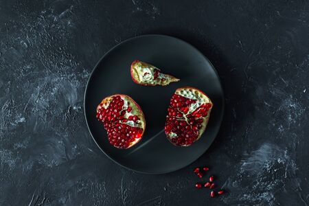ripe red pomegranate on and grain on a gray background Stok Fotoğraf - 133878362