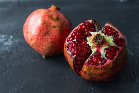 ripe red pomegranate on and grain on a gray background Stok Fotoğraf - 133879179