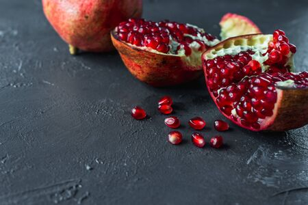 ripe red pomegranate on and grain on a gray background Stok Fotoğraf - 133879698
