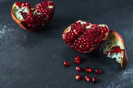 ripe red pomegranate on and grain on a gray background Stok Fotoğraf - 133879705