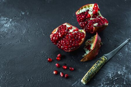 ripe red pomegranate on and grain on a gray background Stok Fotoğraf - 133879706