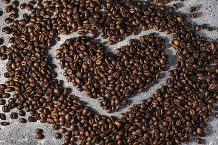 coffee beans on burlap background with copy space for text