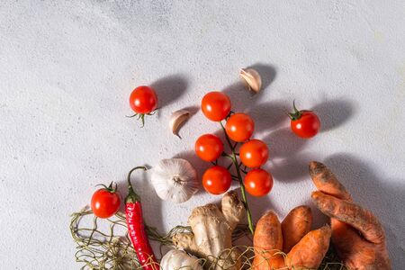 useful vegetables in a reusable cotton bag on a light background