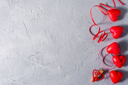 Valentines day abstract background with hearts and ribbons with place for your text