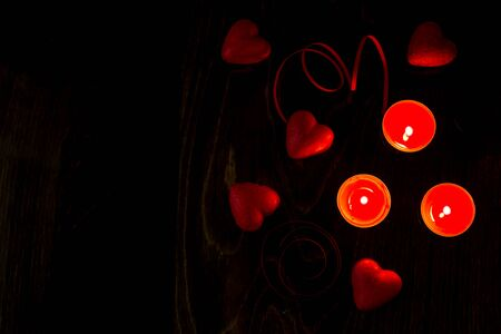 Valentines day romantic background with hearts and candles. holiday background with hearts. Celebrating weddings and other celebrations with space for text