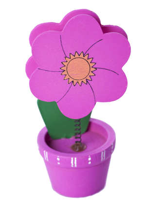 Pink flower pin. Notes holder isolated.  Stock Photo