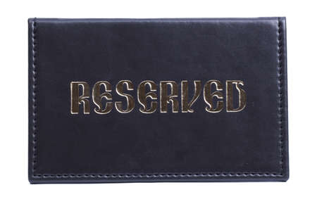 Leather reserved sign isolated on white Stock Photo - 12823859