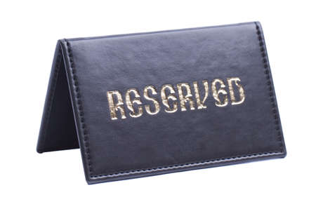 Leather reserved sign isolated on white photo