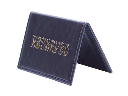booked: Leather reserved sign isolated on white