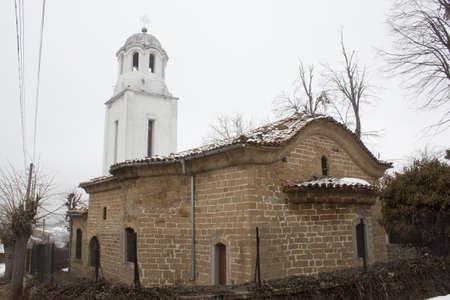 Small village christian church in winter photo