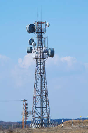 Telecomunication tower against blue sky. Stock Photo