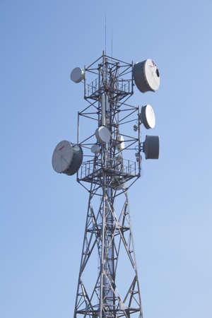 Telecomunication tower against blue sky. photo