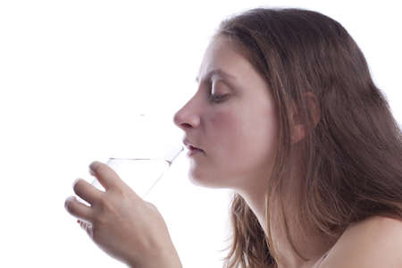 Woman's drinking water from a glass Stock Photo - 13162811