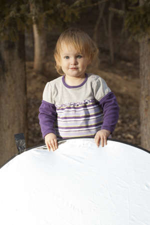 reflector: Baby playing in a park with reflector