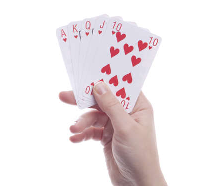 Womans hands holding playing cards. Royal flush. Isolated.