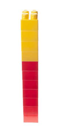 plastic bricks: Plastic bricks stack. Red and yellow, isolated.
