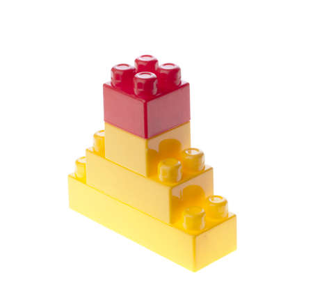 Yellow constructor pyramid with red top. isolated. photo