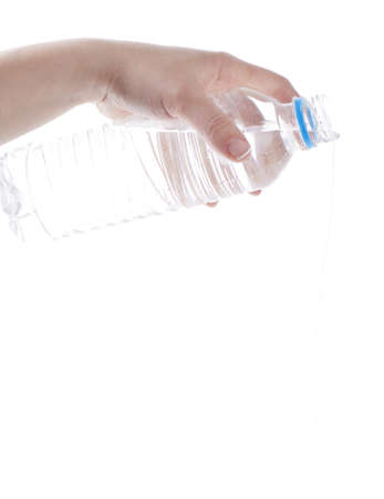 Woman pouring out water froma plastic bottle