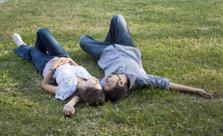 Young couple lying on the ground Stock Photo