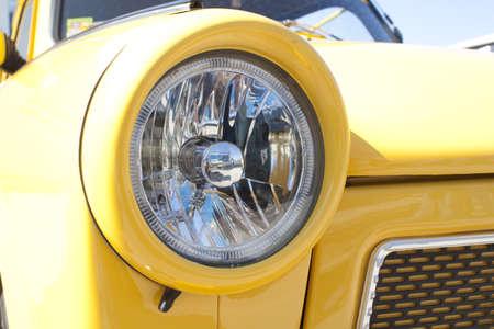 Yellow car head lights. Auto Show. Stock Photo