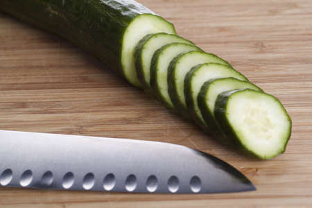 Sliced cucumber with knife on cutting board Stock Photo - 13591541