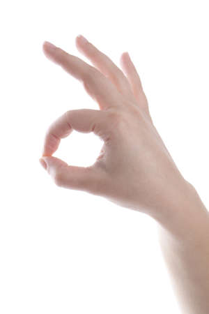 ok symbol: Womans hand is showing ok symbol. isolated on white.