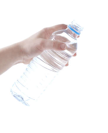 Woman pouring out water froma plastic bottle Stock Photo - 13691120