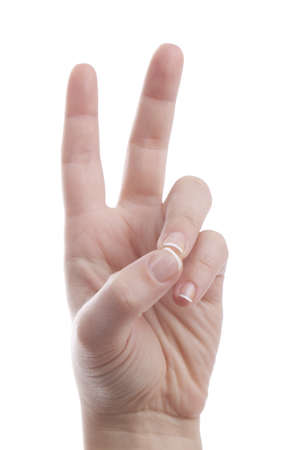 Womans hand showing peace sign Stock Photo
