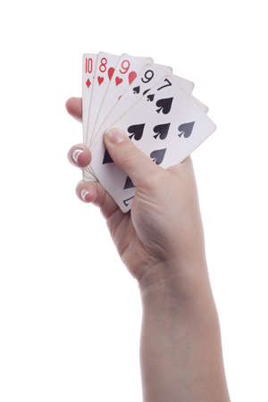Woman holding playing cards, isolated. photo