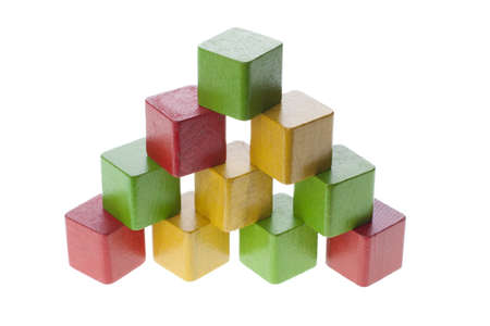 Pyramid built with wooden play cubes isolated