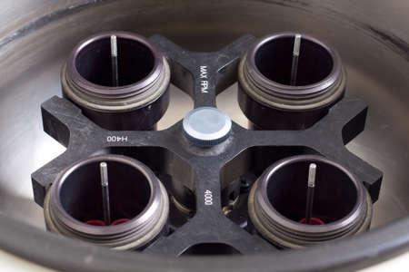 centrifuge: Laboratory centrifuge equipment close up shot