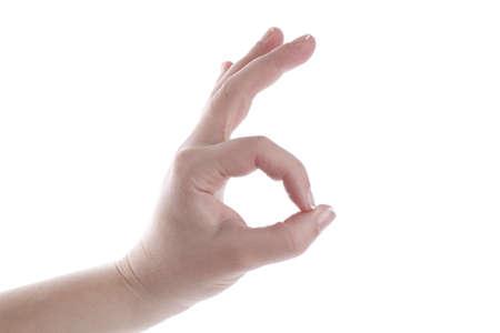 ok symbol: Mano della donna sta mostrando il simbolo ok. isolato su bianco.