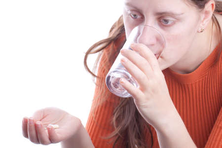 Woman taking pills portrait on white Stock Photo