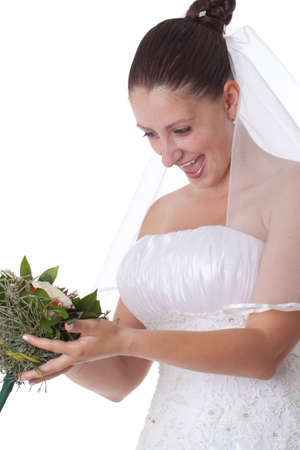 Bride in white holding a boquet isolated