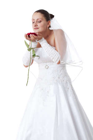 Bride in white holding a red rose. Isolated