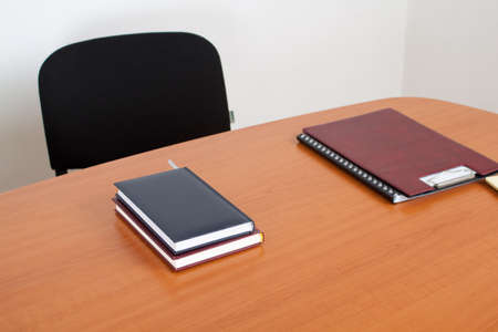 Desk with documents and books. Meeting room interiror. Stock Photo