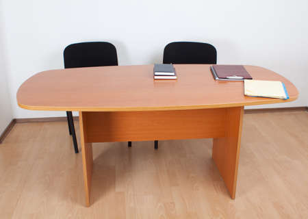 Desk with documents and books. Meeting room interiror. photo