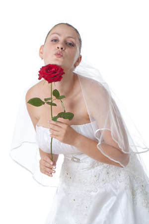 Bride in white holding red rose isolated